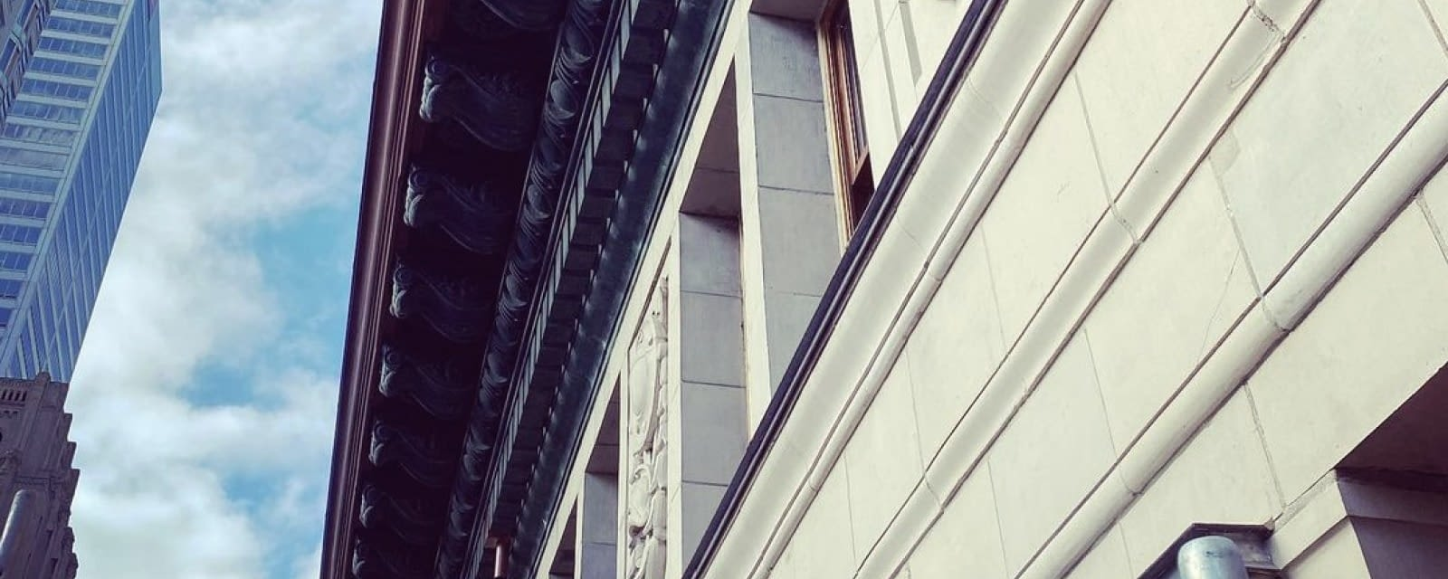 Contact Roof Tile Management - Close-up of masonry trim on a building in downtown Toronto