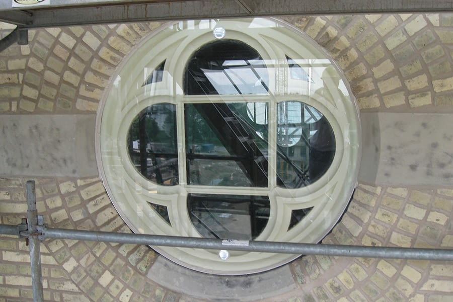 Our Lady of Mercy Church side view of window restoration project Circular Window historical Restoration